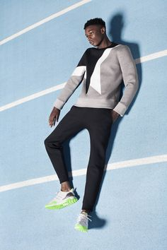 Shot on location at Lee Valley athletics, STYLED II/III demonstrates the diversity of our street and sportswear-inspired offering for AW15, with particular emphasis on our new brands for the season. The anticipated debut collection from adidas x KOLOR sits alongside CMMN SWDN's 90s football-inspired offering and Neil Barrett and OAMC's luxurious urban-influenced designs, with premium running sneakers provided by Lanvin and 288.