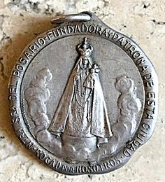Large Signed Antique 1800's Medal Madonna Virgin Mary Jesus (Image1)Large 19th century religious medal, Signed By Artist Juan Gottuzzo (1858 – 1924) from Argentina, featuring the Blessed Mother Virgin Mary wearing an ornate crown and holding the Christ Child Jesus as Our Lady of the Rosary.