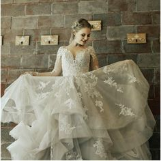 Lace Wedding Dress with Full Skirt & Illusion Sleeves   Game of Thrones Inspired Wedding with photos by Brittany Photographs   The Pink Bride®️️️ www.thepinkbride.com