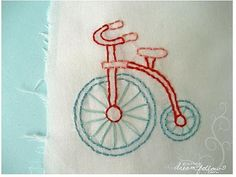 Link to this cute tricycle embroidery pattern from here.