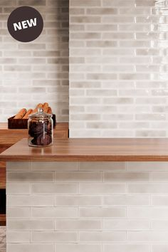 Pale taupe glossy wall tiles that feature a crackle glaze finish. Metro Tiles, Shower Screen, Kitchen Tiles, Building Materials, Bath Caddy, Kyoto, Wall Tiles, Hue, Bathrooms
