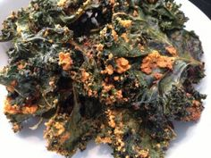 """If you love kale chips like me, but hate to pay $7.00 for a small bag – this is the perfect recipe for you.  These kale chips are amazing!  They taste just like the """"Mango Habanero"""" flavor from Rhythm Superfoods.  A little spicy cheese flavor and such an easy recipe - pin now and make later."""