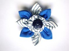 Handmade GUIDES / LEADERS Flower with Navy Blue Logo Girl Guide Button and Vintage GGC Striped Uniform Fabric. $6.00, via Etsy.