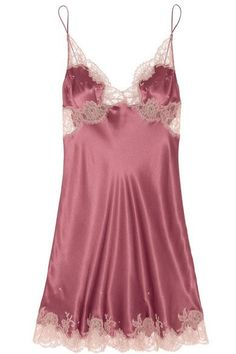 CARINE GILSON Lace-trimmed silk-satin mousseliné chemise $1,195EDITORS' NOTES & DETAILS Carine Gilson's fluid raspberry silk-satin mousseliné chemise has been handcrafted by artisans in her studio in Brussels and cut for a relaxed silhouette. Antique-rose lace trims flatter the bust and emphasize the elegant length.  Slips on 100% silk Dry clean Designer color: Rosewood/ Roselyne