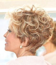 Softly sculpted curls create this sophisticated, cropped silhouette. THE NEW ROMANTIC by Raquel Welch is a timeless short wig that delivers desired fullness and styling ability from the multilayered top, while finishing off with a softly blended, tapered Pixie Cut Curly Hair, Thick Curly Hair, Short Hair Cuts, Curly Hair Styles, Short Curly Hairstyles For Women, Permed Hairstyles, Raquel Welch Wigs, Hair Evolution, Short Haircut Styles