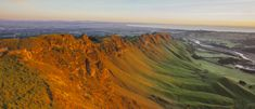 Te Mata Peak, behind Havelock North, gives views of Hawke's Bay. Visitors can see Napier and Mahia Peninsula to the north and east, hill country to the sou. Mount Ruapehu, Maori Legends, Havelock North, Abseiling, On A Clear Day, Redwood Forest, Hang Gliding, Trail Maps, Entrance Gates