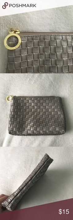 Estée Lauder makeup bag - Gorgeous platinum color with woven pattern  - Gold detailing  - No blemishes on the outside of the bag - Minor marks on the interior - can be wiped off due to the interior material  - Body 100% PVC  - Polyester lining   Please ask questions before buying since all sales are final. Estee Lauder Bags Cosmetic Bags & Cases