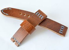 Hard leather orange light brown blue stitching watch strap