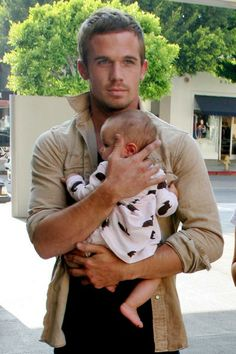 Okay seriously with attractive men holding babies? I can't handle this much cuteness.
