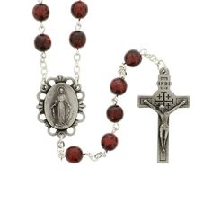 Burgundy Rosary with Relic.  This glass bead rosary houses a relic inside the crucifix that touched the Holy Sepulchre in Jerusalem. A beautiful devotional made by Christian families in Bethlehem.