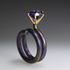 Ring | Ela Cindoruk.  18k gold, titanium, amethyst.