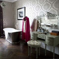 Venetian mirror, tub, stenciled wall paper