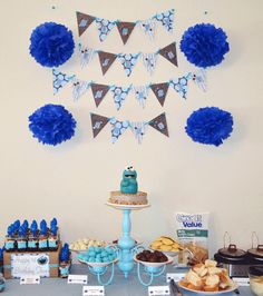Oh my, check out the awesome cake stand/dessert stand..repurposed chandelier for this Cookie Monster Birthday Party.