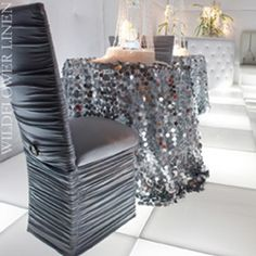 Sequinned tablecloth in dark silver, but not these chairs.