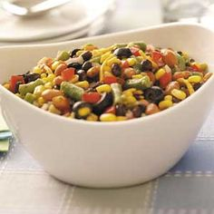 I love this salad, I change it up with omitting the olives, cheese and pinto beans.  I just use 2 cans of black beans...super yummy!  I am always asked for this recipe!!