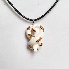White Pied Ball Python Necklace. Handmade, Polymer Clay Reptile Pendant, Crafted by The Clay Kiosk on Etsy.