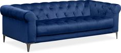 Love to Lounge! Revive your décor through the elegant addition of the David sofa. Dignified diamond tufting and rich indigo velour upholstery create timeless appeal. The graceful silhouette showcases a rolled back and arms, while tapered chrome legs provide a modern edge, making this a wonderful and exquisite addition to your living space.