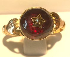 1830s  Georgian Garnet Cabochon Ring with Rose Cut Diamond in 14k Gold by PassItOnLTD on Etsy https://www.etsy.com/listing/237785465/1830s-georgian-garnet-cabochon-ring-with