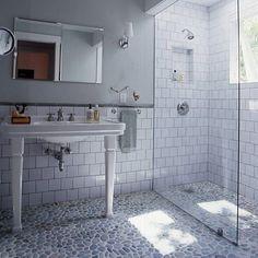 Pebble Tile floor with subway tile wall.