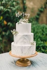 Soft grey marbled fondant 3 tier wedding cake with laser-cut topper