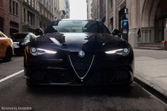 Our $77,195 test car came with a Vulcano black paint job and Alfa's distinctive front grille, an inverted triangle that evokes the brand's heritage. The Alfa badge, by the way, is probably the most beautiful in the automotive universe.