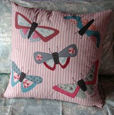 All a Flutter, pillow with butterfly appliqués
