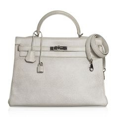 Guaranteed authentic Hermes Kelly Retourne 35 rare Gris Perle and White Dalmation featured in Buffalo... Hermes Bags, Hermes Kelly, Buffalo, Keys, Shoulder Strap, Hardware, Colour, Water, Products