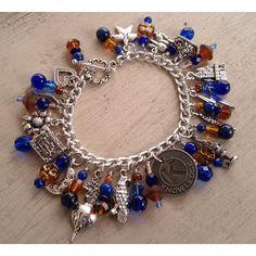 Luna's Ravenclaw Charm Bracelet ($55) ❤ liked on Polyvore featuring jewelry, bracelets, harry potter, flower jewelry, wing charms, eagle charm, charm bracelet bangle and star charm bracelet