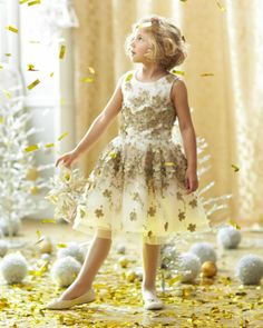 Zoe Leaves Of Gold Girls Dress - Looking for something extra special? This dazzling dress is sure to stand out in the crowd. An abundance of three-dimensional leaves are set on layers of tulle, organza and ivory satin. Made in USA.