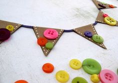 A kraft paper banner decorated with spunky polka dots and colorful buttons.