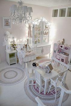 Stunning shabby chic white little girls room.