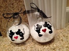 This cute 4 inch snow filled ornament will make the perfect gift for that Disney lover Disney wedding gift. Leave note to seller heart color choice $7