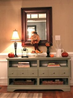 DIY...turn an old dresser to a console table. This example is also great when your piece is missing drawers.