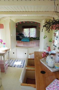 Gypsy Wagon Interior, love the build in alcove bed in kitchen.....good for when its really cold in winter