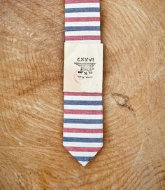"This organic cotton dungaree tie is the perfect classic cut to match any outfit. They are constructed by hand in a small family owned factory in Chicago of small run Japanese fabric. It measures 58"" long and 2.5"" wide at its widest part."