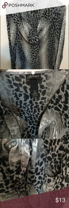 Lane bryant leopard career dressy blouse top Gently used no flaws Womens lane bryant long sleeve top has drawstring on the size for size adjustment(length) Black and white leopard print Loose fit Size 22/24 Lane Bryant Tops Blouses
