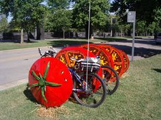 Tomato Bicycle Rack, this looks like a great idea for parking bikes at community gardens!