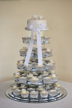 Silver and White CHEESECAKE: Wedding Cupcakes with SILVER M&M's and I need a cake topper