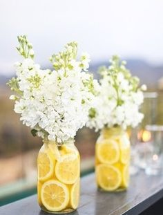 When life gives you lemons...accessorize! Cute outdoor vase idea!