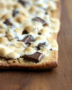 S'mores Pizza Recipe ~ Says: I made a flatbread like pizza crust and brushed it with melted butter, topped it with graham cracker crumbs, mini Hershey's bars and mini marshmallows. Throw the pizza in the oven and in twenty minutes you get a perfectly melty, chocolatey, marshmallowy s'more that is gooey and absolutely to die for.