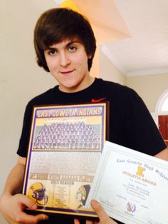 Sam with his football awards 2013