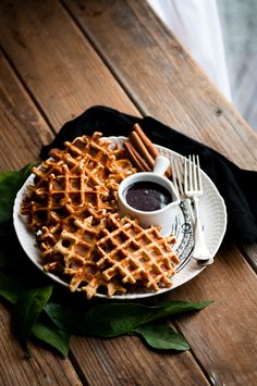 Orange cinnamon waffles with dark chocolate hot fudge.