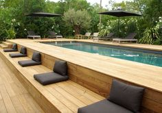 Above ground pool ideas to beautify a prefab swimming pool and give it a custom look. Ideas include above ground pool decks, modern landscaping and siding. #ModernLandscape