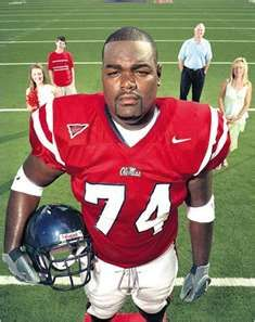 Michael Oher at Ole Miss with his adoptive family in the backround