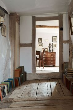 """[i]Harriet's grandmother's books line the landing to a spare room.[/i] Like this? Then you'll love [link url=""""http://www.houseandgarden.co.uk/interiors/hallway""""]Hallway ideas to steal[/link]"""