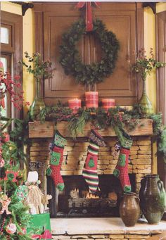 how prettylove the large candles with the greenery someday i - Pinterest Decorating Mantels For Christmas