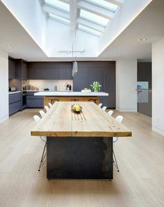Skylight love, dark cabinetry, timber feature