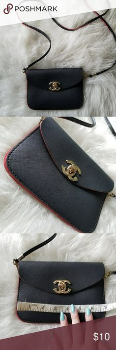 Black and red purse It is chanel inspired  the purse is super cute and super small so ur phone fits and thin wallet   Free shipping bundles of 4 or more Or add to bundle and I will give you shipping discount Bags Crossbody Bags