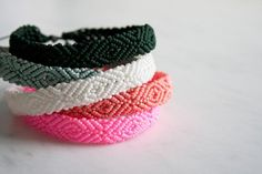 As a child of the I can confirm that friendship bracelets were all the rage. I had the Klutz book with the special little thread pouch, and my best friend and I literally started a business… Friendship Bracelet Kit, Diy Friendship Bracelets Patterns, Hand Bracelet, Monochrome, Diy Jewelry, Jewelry Making, Jewlery, Do It Yourself Jewelry, Purl Soho