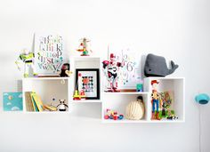Great offset box arrangement for kids storage — white on white makes the colourful items pop